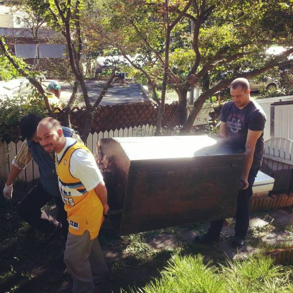 Joe and Luke carrying a whole pig into our garden.